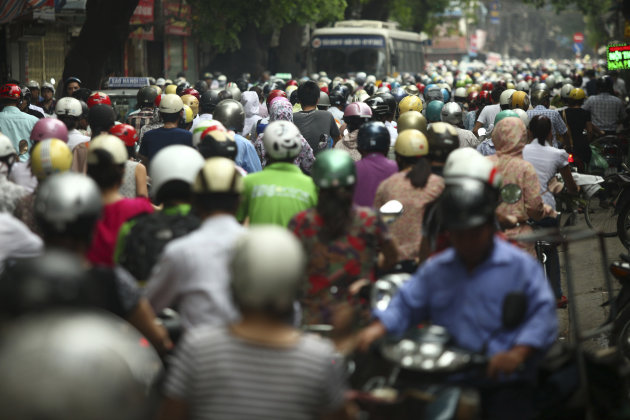 In this photo taken Monday, May 21, 2012, motorcyclists drive in rush hour on La Thanh street which is one of the worst traffic jam roads, in Hanoi, Vietnam. The project of expanding the street is del