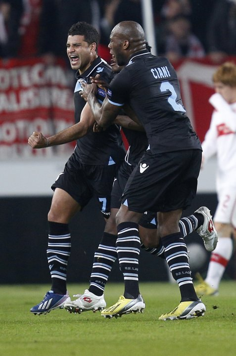 Lazio's Ederson celebrates with team mate Ciani after scoring a goal during their Europa League soccer match against VfB Stuttgart in Stuttgart