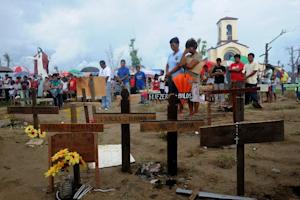 Relatives of the victims of Tyhpoon Haiyan attend an …