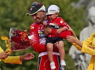 Geox-TMC team member Juan Cobo and his nephew Hugo, celebrates his victory on the podium in the Spanish Vuelta in Madrid, Spain, Sunday, Sept. 11, 201