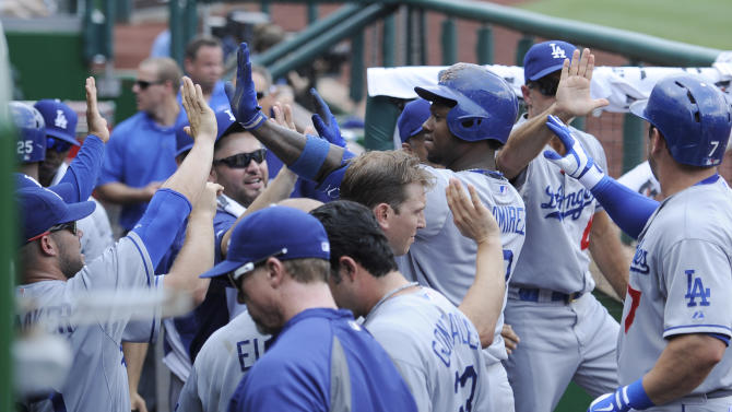 Los Angeles Dodgers' Hanley Ramirez, center, celebrates his three-run home run in the dugout with teammates against the Washington Nationals during the second inning of a baseball game on Sunday, July 21, 2013, in Washington. (AP Photo/Nick Wass)