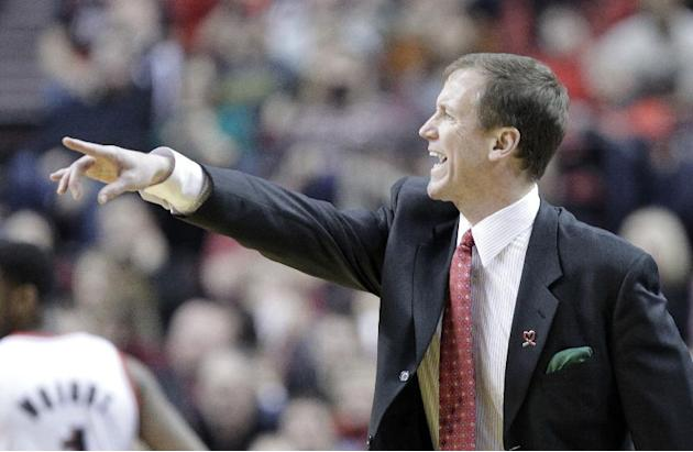 Portland Trail Blazers coach Terry Stotts gestures from the bench during the second half of an NBA basketball game against the New Orleans Pelicans in Portland, Ore., Saturday, Dec. 21, 2013. Portland