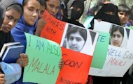 Pakistani students in Lahore protest against the assassination attempt on Malala Yousafzai. The 14-year-old Pakistani girl shot in the head by the Taliban is making progress in a British hospital, doctors said