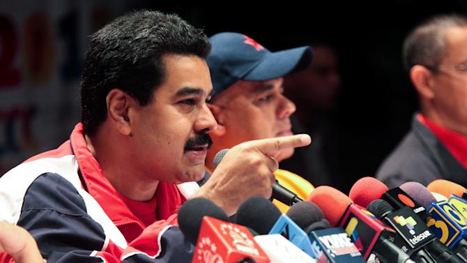 In this photo released by Miraflores Press Office, Venezuela's Vice-President Nicolas Maduro speaks during a news conference in Caracas, Venezuela, Sunday, Dec. 16, 2012. Venezuelans are choosing governors and state lawmakers in elections that have become a key test of whether President Hugo Chavez's movement can endure if the socialist leader leaves the political stage.  (AP Photo/Miraflores Press Office)