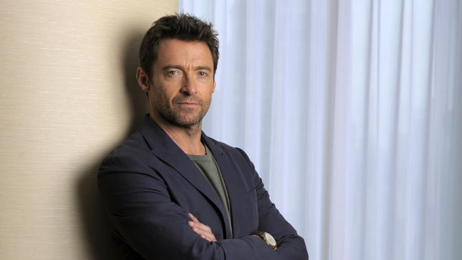 "This Sept. 7, 2013 photo shows Hugh Jackman, a cast member in the film ""Prisoners,"" on day 3 of the 2013 Toronto International Film Festival in Toronto. (Photo by Chris Pizzello/Invision/AP)"
