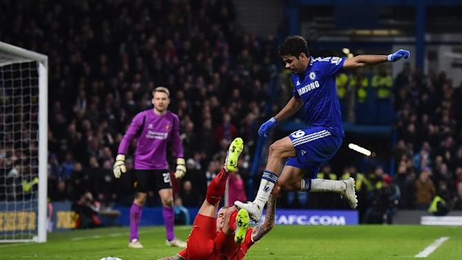 Diego Costa (R) treads on Martin Skrtel during the League Cup semi-final second leg between Chelsea and Liverpool at Stamford Bridge on January 27, 2015