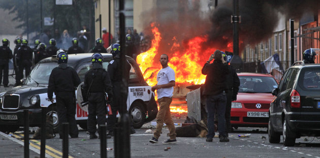 British police officers charge rioters, during riots in Hackney, east London, Monday Aug. 8, 2011. Youths set fire to shops and vehicles in a host of areas of London _ which will host next summer's Ol