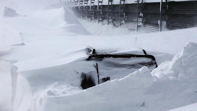 In this photo taken Sunday, March 3, 2013, a vehicle of Kazuyo Miyashita is buried in the snow along a road in Nakashibetsu, Hokkaido, northern Japan. Kyodo news service says Miyashita and her three children died at a hospital Saturday night of carbon-monoxide poisoning after the vehicle got buried in the snow. Heavy snow that fell on the main northern Japanese island of Hokkaido over the weekend has killed eight people, including the family. (AP Photo/The Hokkaido Shimbun Press via Kyodo News) JAPAN OUT, MANDATORY CREDIT, NO LICENSING IN CHINA, HONG KONG, JAPAN, SOUTH KOREA AND FRANCE