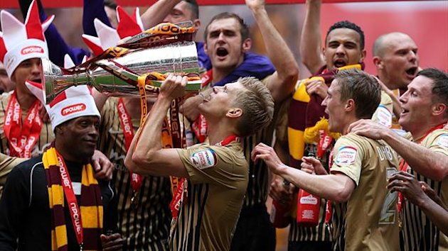Bradford City's Alan Connell drinks from the npower Football League Two Play-Off Trophy