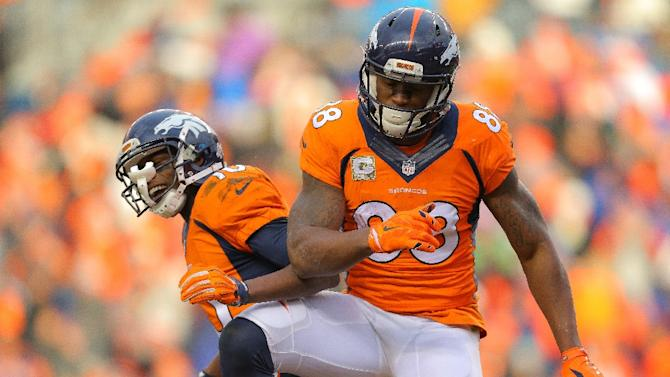 Wide receiver Demaryius Thomas (R) of the Denver Broncos celebrates a touchdown on November 23, 2014 in Denver, Colorado