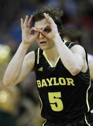 Baylor guard Brady Heslip (5) celebrates a 3-point basket during the second half of an NCAA college basketball game against Kansas in the Big 12 Conference tournament Friday, March 9, 2012, in Kansas City, Mo. Baylor defeated Kansas 81-72. (AP Photo/Orlin Wagner)