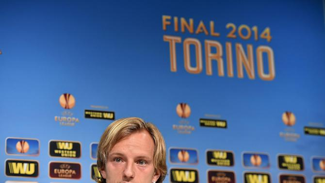 In this photo made available by Uefa, Sevilla FC captain Ivan Rakitic speaks during a press conference ahead of tomorrow's final of the Europa League against Benfica, at the Juventus stadium in Turin, Italy, Tuesday, May 13, 2014 ( AP Photo/Uefa, HO)