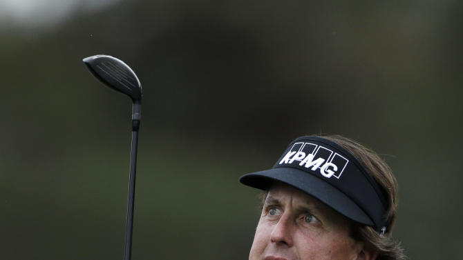 Phil Mickelson grimaces as he watches his tee shot on the 10th hole of the north course at the Torrey Pines Golf Course during the first round of the Farmers Insurance Open golf tournament Thursday, Jan. 24, 2013, in San Diego. (AP Photo/Gregory Bull)