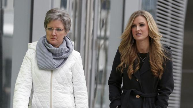 Boston Marathon bombing survivor Rebekah Gregory, right, and an unidentified woman arrive outside federal court, Thursday, March 5, 2015, in Boston, during the federal death penalty trial of Dzhokhar Tsarnaev, who is charged with conspiring with his brother to place two bombs near the Boston Marathon finish line that killed three and injured 260 people in April 2013. (AP Photo/Michael Dwyer)