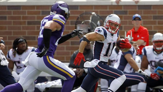 New England Patriots wide receiver Julian Edelman, right, runs with the ball past Minnesota Vikings free safety Harrison Smith after catching a pass during the second quarter of an NFL football game Sunday, Sept. 14, 2014, in Minneapolis. Edelman picked up 44 yards on the play
