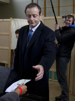Leader of the NVA party Bart De Wever receives his voting card at a polling station in Antwerp, Belgium, on Sunday Oct. 14, 2012. NVA, a separatist party, wants to use Antwerp as a base for breaking away from Belgium, putting it in the forefront of a European breakaway trend just as the EU celebrates winning the Nobel Peace Prize for fostering continental unity. (AP Photo/Virginia Mayo)