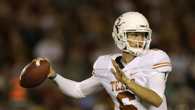 Texas quarterback Case McCoy throws a pass during the first half of an NCAA college football game against Iowa State, Thursday, Oct. 3, 2013, in Ames, Iowa. Texas won 31-30. (AP Photo/Charlie Neibergall)