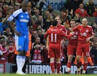 File picture shows Liverpool players celebrating a goal during their 4-1 win at Anfield in May. Chelsea manager Roberto Di Matteo admits Liverpool have become Chelsea&#39;s &quot;bogey team&quot; ahead of the visit of Brendan Rodgers&#39; side to Stamford Bridge on Sunday