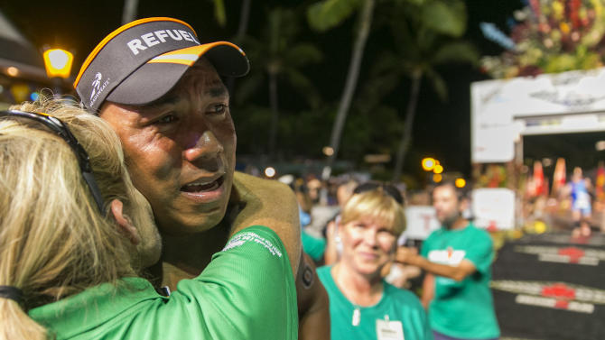 IMAGE DISTRIBUTED FOR GOPRO IRONMAN - Super Bowl Champion and BECOME ONE athlete Hines Ward, center, reacts with his coach, eight time IRONMAN World Champion Paula Newby Fraser, after crossing the finish line at the 2013 GoPro IRONMAN World Championship in Kailua-Kona, Hawaii on Saturday, Oct. 12, 2013. (Marco Garcia/AP Images for GoPro Ironman)