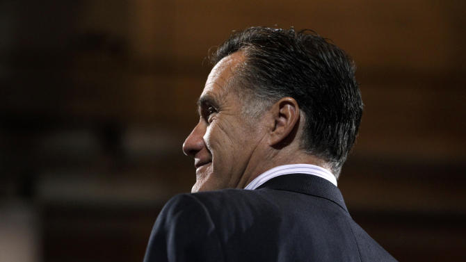 Republican presidential candidate, former Massachusetts Gov. Mitt Romney smiles during his campaign rally at Consol Energy Research and Development Facility in South Park Township, Pa., Monday, April 23, 2012. (AP Photo/Jae C. Hong)