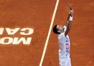 Serbia&#39;s Novak Djokovic reacts at the end of his Monte-Carlo ATP Masters Series Tournament tennis match he won after having learnt the death of his grandfather earlier in the day, in Monaco. Djokovic won against Ukraine&#39;s Alexandr Dolgopolov, 2-6, 6-1, 6-4