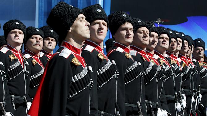 Russian Cossacks take part in a rehearsal for the Victory Day parade in Red Square in central Moscow