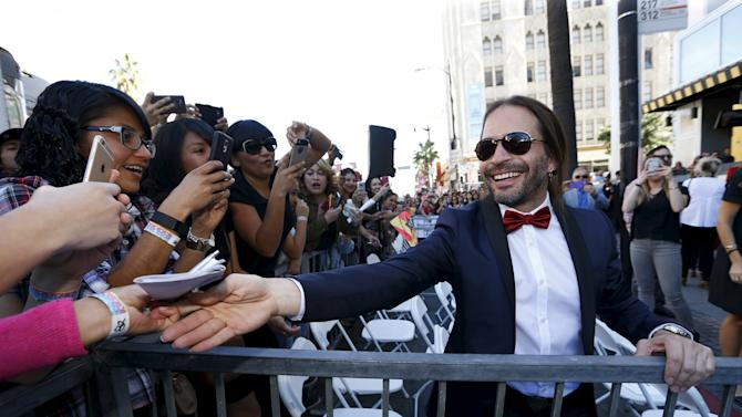 Vallin of Mexican rock band Mana greets fans after unveiling their star on the Hollywood Walk of Fame in Los Angeles
