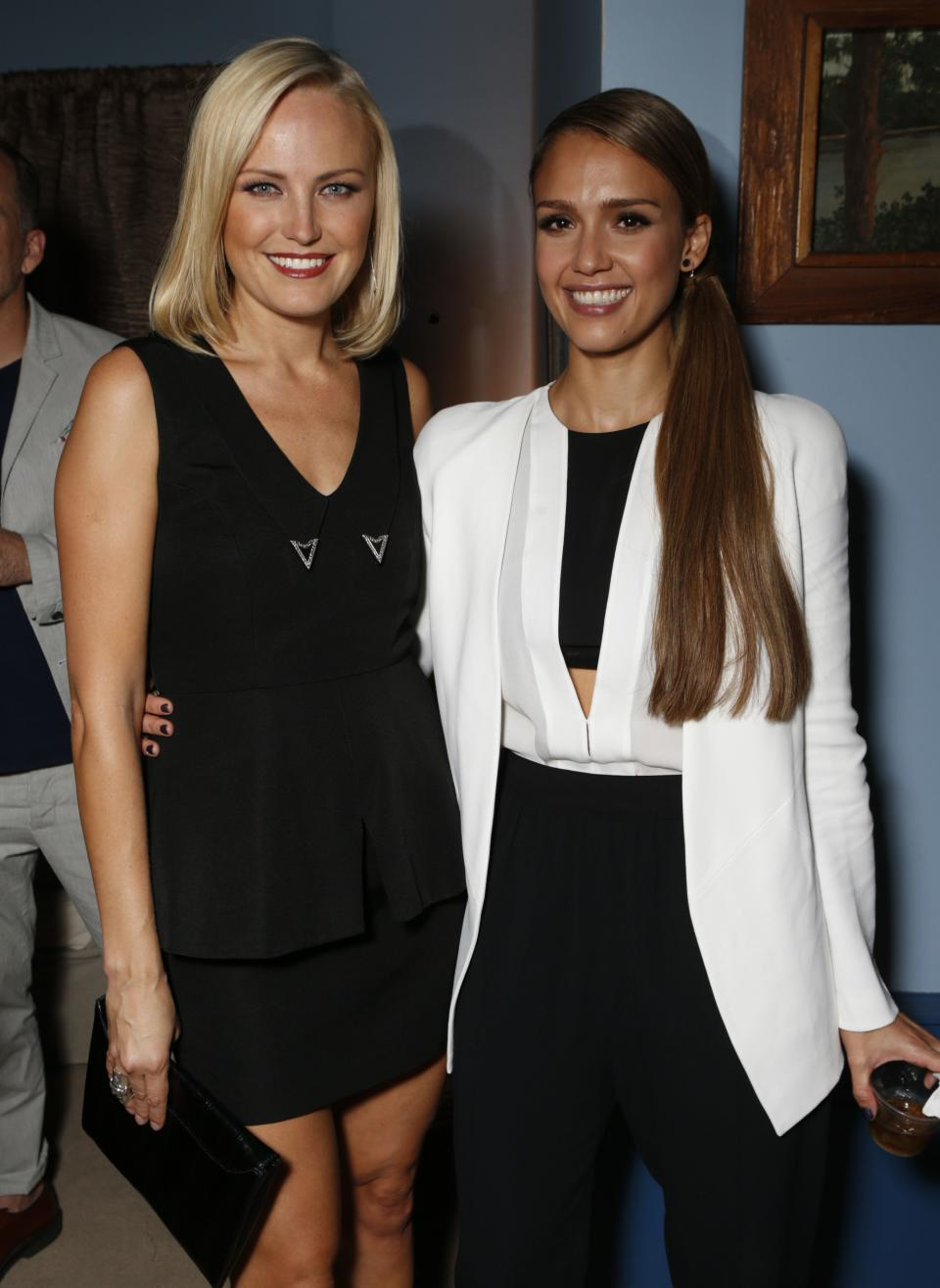 IMAGE DISTRIBUTED FOR  ENVIRONMENTAL MEDIA ASSOCIATION - Malin Akerman, left, and Jessica Alba are seen backstage at the 22nd Annual Environmental Media Awards on Saturday Sept. 29, 2012, at Warner Bros. Studios in Burbank, Calif. (Photo by Todd Williamson/Invision for Environmental Media Association/AP Images)