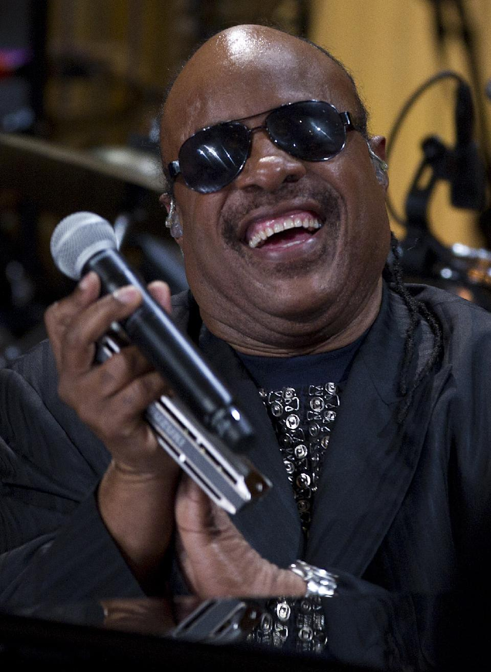 "Stevie Wonder smiles after performing during the ""In Performance at the White House"" in the East Room of the White House Wednesday, May 9, 2012, in Washington, honoring songwriters Burt Bacharach and Hal David, recipients of the 2012 Library of Congress Gershwin Prize for Popular Song.  (AP Photo/Carolyn Kaster)"