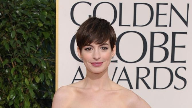 Actress Anne Hathaway arrives at the 70th Annual Golden Globe Awards at the Beverly Hilton Hotel on Sunday Jan. 13, 2013, in Beverly Hills, Calif. (Photo by John Shearer/Invision/AP)