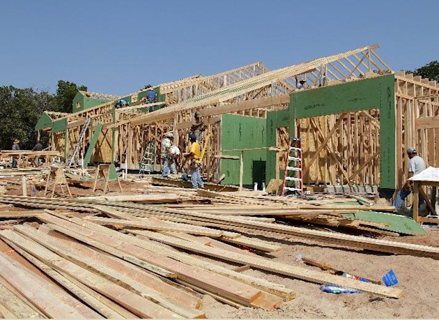 In this Sept. 12, 2012, photo, new homes are under construction in Edmond, Okla. Nearly all regions of the United States are reporting that stronger housing markets have helped boost economic growth since the middle of August, according to a survey relased Wed. Oct. 10, 2012, by the Federal Reserve. The Fed says growth improved in 10 of its 12 regional banking districts, while leveling off in one region and slowing in another. Rising home sales helped lift home prices. (AP Photo/Sue Ogrocki)