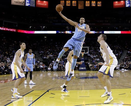 Warriors hold off Nuggets 106-105 in wild finish