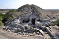This handout photo, provided by the Bulgarian National Institute of Archeology, shows the remains of a small settlement made of two-story houses near the town of Provadia in eastern Bulgaria. Archeologists have uncovered the remains of what could be the oldest prehistoric city in Europe founded around a salt mine and dating back to the fith millennium BC