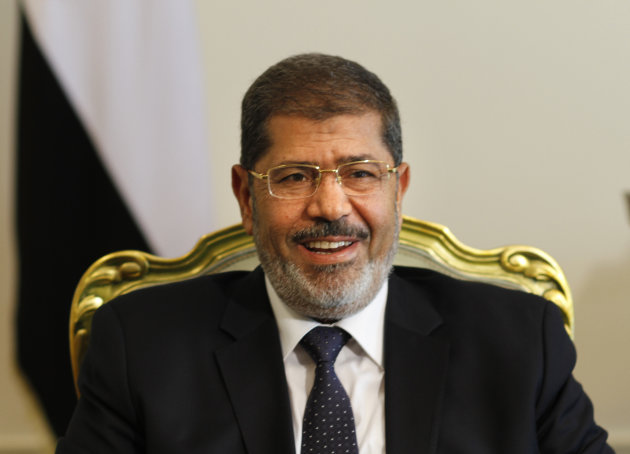 Egypt's newly elected President Mohammed Morsi smiles as he meets with Bulgarian foreign minister, not pictured, in Cairo, Egypt, Tuesday, July 31, 2012. (AP Photo/Amr Nabil)