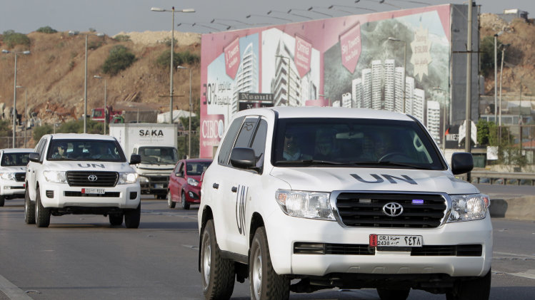 The convoy of a U.N. team of weapons inspectors, who concluded its almost week-long mission in Syria, arrive at Rafik Hariri international airport in Beirut, Lebanon, Monday, Sept. 30, 2013. The inquiry determined that the nerve agent sarin was used in the Aug. 21 attack on a Damascus suburb in Syria, but it did not assess who was behind it. (AP Photo/Bilal Hussein)