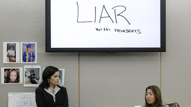The words shown on a overhead display written by prosecutor Eren Price, left, are shown in court as an emotional Elizabeth Escalona, 23, responds to a line of questioning during the sentencing phase of her trial Thursday, Oct. 11, 2012, in Dallas. Escalona, a young mother of five who admitted beating her toddler and gluing her hands to a wall, faces anywhere from probation to life in prison. (AP Photo/Tony Gutierrez)