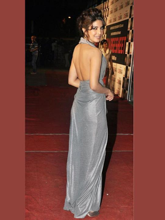 Images via : iDiva.comPriyanka Chopra looks gorgeous in this grey halter gown. Her back looks well toned and hot!Related Articles - Celeb Trend: Sexy Net SarisVote: Hottest Celebrity in Lace!