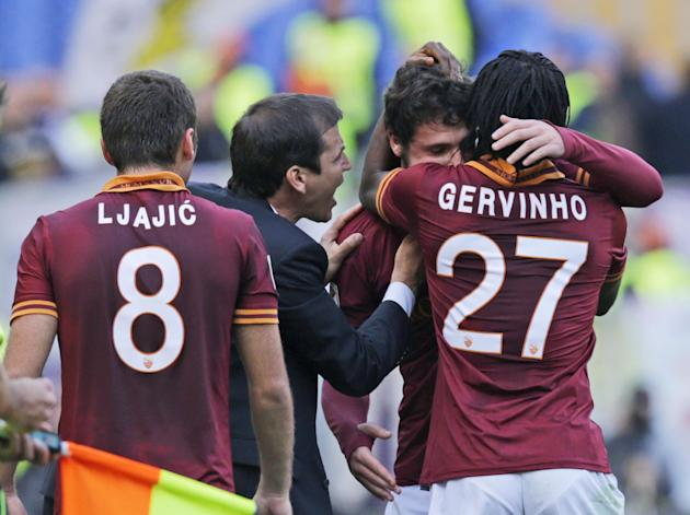 AS Roma forward Mattia Destro, second from right, celebrates with his teammates, from left, Adem Ljajic, of Serbia, coach Rudi Garcia, of Franc,e and Gervinho, of the Ivory Coast, after he scored duri