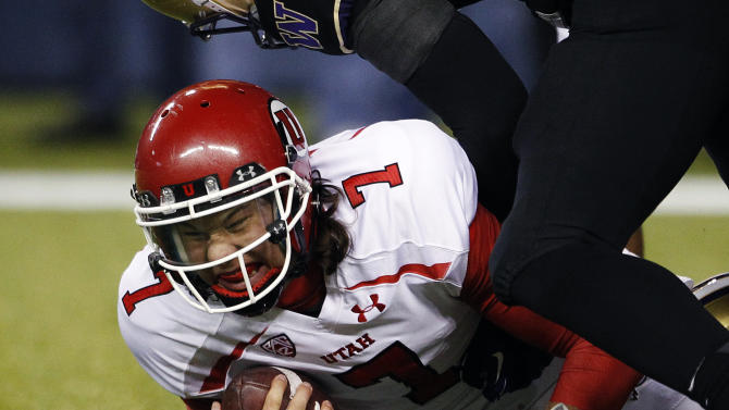 FILE - In this Nov. 10, 2012, file photo, Utah quarterback Travis Wilson is sacked against Washington late in the second half of Utah's 34-15 loss in an NCAA college football game in Seattle. With the realignment of conferences the past few years, it often means adjusting to a new style of football for teams that are switching. Previously BCS busters in the Mountain West Conference, Utah got off to a bad start in the newly-formed Pac-12's South Division last season but managed to finish 8-5. In the team's second year, Utah (4-6) is 2-5 in the Pac-12, with four of those losses coming in a row. (AP Photo/Elaine Thompson, File)