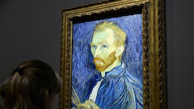 A A visitor looks at a self-portrait by Vincent Van Gogh displayed at the Orsay Museum in Paris