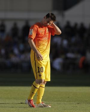 FC Barcelona's Lionel Messi from Argentina reacts during a Spanish La Liga soccer match against Atletico de Madrid at the Vicente Calderon stadium in Madrid, Spain, Sunday, May 12, 2013. (AP Photo/Andres Kudacki)