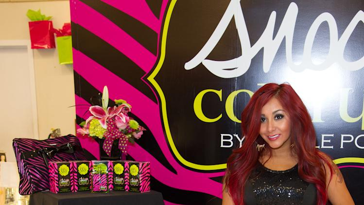 "Nicole ""Snooki"" Polizzi hosts a meet and greet at a Perfumania for the release of her second fragrance, ""Snooki Couture"" on Wednesday, January 9, 2013, in Las Vegas, NV (Photo by Al Powers/Powers Imagery/Invision/AP)"