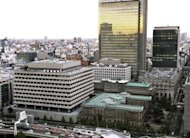 The Bank of Japan headquarters in central Tokyo. The Bank of Japan has followed its US and European counterparts in announcing extra bond buying to take its total monetary easing effort past $1 trillion as it seeks to revitalise the economy