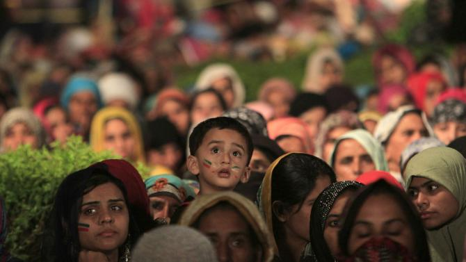 A boy is pictured in a crowd of supporters of Qadri, Sufi cleric and leader of political party Pakistan Awami Tehreek (PAT), outside the parliament house in the Red Zone during the Revolution March in Islamabad
