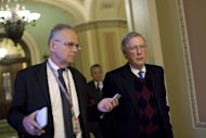 Senate Minority Leader Mitch McConnell (R) walks toward his office after speaking on the Senate Floor on Capitol Hill on December 27, 2012 in Washington. US President Barack Obama will host top congressional leaders including his bitter Republican rivals on Friday in a last-ditch bid to halt America&#39;s slide over the so-called &quot;fiscal cliff.&quot;