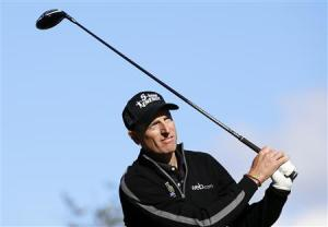 Furyk hits from the eighth tee during the second round of the BMW Championship golf tournament in Lake Forest