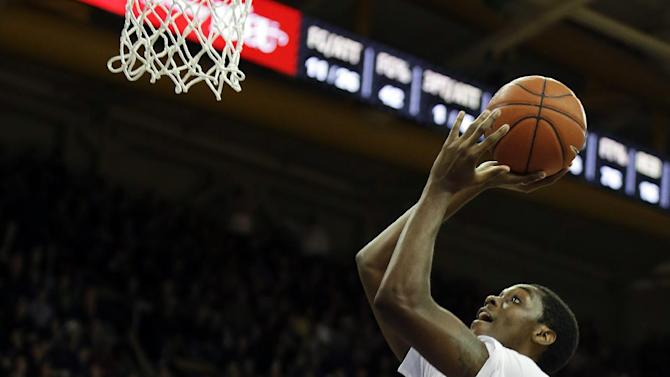 Washington's Jernard Jarreau puts up a shot above UCLA's David Wear (12) and Kyle Anderson (5) during the first half of an NCAA college basketball game, Saturday, March 9, 2013, in Seattle. (AP Photo/Ted S. Warren)