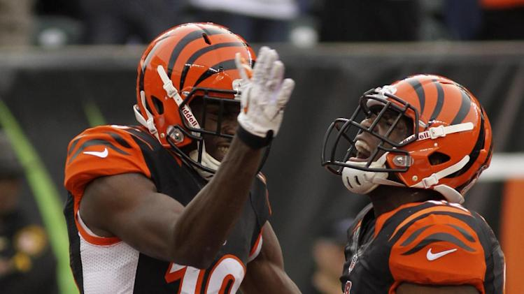 Cincinnati Bengals wide receiver Mohamed Sanu (12) celebrates with wide receiver A.J. Green (18) after catching a 10-yard touchdown pass against the New York Giants in the second half of an NFL football game on Sunday, Nov. 11, 2012, in Cincinnati. (AP Photo/Tom Uhlman)