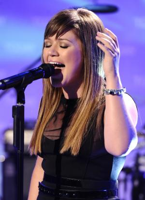 """In this image released by NBC, singer Kelly Clarkson performs on the """"Today"""" show on Tuesday, Oct. 25, 2011 in New York. Clarkson was promoting her latest release, """"Stronger."""" (AP Photo/Peter Kramer)"""