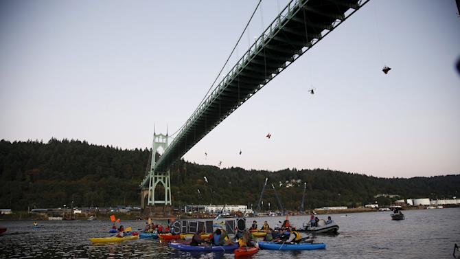 Activists hang under the St. Johns Bridge in an attempt to block the Shell leased icebreaker, MSV Fennica, in Portland, Oregon